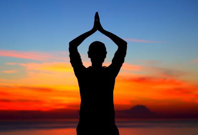 Doing yoga exercises outdoors